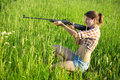 Girl with air rifle Royalty Free Stock Photo