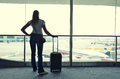 Girl in the airport at window Royalty Free Stock Photography