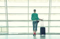 Girl at the airport window Stock Photography
