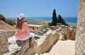 Girl among ancient ruines of kourion in cyprus Stock Photo