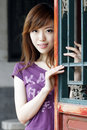 A girl by the ancient window . Royalty Free Stock Photo