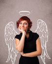 Girl with angel illustrated wings on grungy background