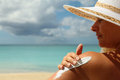 Girl aplying  sun protection cream Royalty Free Stock Photo