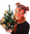 Girl in appearance a tiger with a new-year tree. Stock Photo