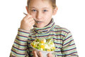 Girl with appetite eats dessert ice cream and fruits Stock Image