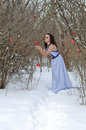 Girl with apple in a dress disrupts the in the winter Stock Images