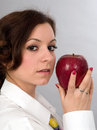 Girl with apple a eating a big red Royalty Free Stock Images