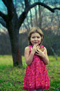 Girl in apple garden Royalty Free Stock Photo