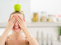 Girl with apple on head closing eyes with hands happy teenage Royalty Free Stock Photography