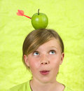 Girl with an apple on her head Royalty Free Stock Photo