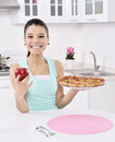 Girl apple and pizza unstable cute young woman Royalty Free Stock Image