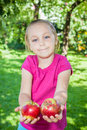 Girl with apples the an in his hand in the garden Royalty Free Stock Photography