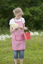 Girl with apron and bouquet of daisies outdoors red white checkered Stock Images