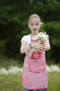 Girl with apron and bouquet of daisies outdoors red white checkered Royalty Free Stock Photos