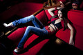 Girl in armchair sexy red background Stock Photos