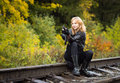 Girl with arms on the rails Royalty Free Stock Photo