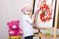 Girl the artist draws on easel bear three year old playing in paints sitting a chair Stock Photography