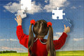 The girl assemble big puzzle Stock Photography