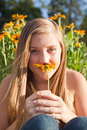 Girl with an aster pretty teenage holding a black eyed susan flower Stock Images