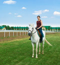 Girl astride a horse Royalty Free Stock Photo