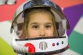 Girl astronaut little with helmet Stock Photos