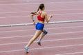 Girl athlet run 400 meters Royalty Free Stock Photo