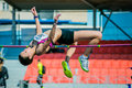 Girl athlete high jump Royalty Free Stock Photo