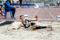 Girl athlete long jump Royalty Free Stock Photo