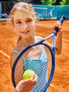 Girl athlete  with racket and ball on  tennis Royalty Free Stock Photo
