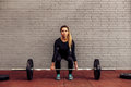 Girl athlete in starting position deadlift Royalty Free Stock Photo