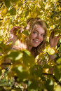 Girl in the autumn branches Royalty Free Stock Images