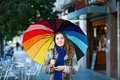 Girl in autumn jacket with umbrella at street Royalty Free Stock Images