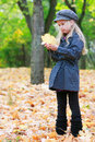 Girl with autumn leaf Stock Photo