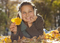 Girl with autumn leaves in the beauty park Stock Images