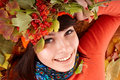 Girl in autumn orange hat on leaf group and berry. Stock Photography