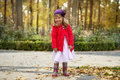 Girl in autumn park little standing Stock Photos