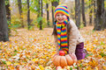 Girl in autumn park with pumpkin and apple apples Stock Photos