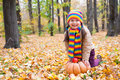 Girl in autumn park with pumpkin and apples Royalty Free Stock Images