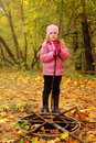 Girl in autumn park stand near rusty hatch Royalty Free Stock Photography