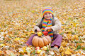 Girl in autumn with pumpkin and apples park Stock Images