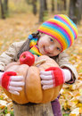 Girl in autumn with pumpkin and apples park Royalty Free Stock Photography