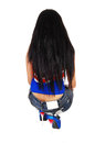 Girl from back a skinny young woman kneeling isolated for white background her in jeans and long black hair Stock Photo