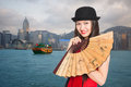 Girl on the background of hong kong beautiful with a fan Royalty Free Stock Photo
