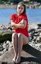 Girl badly frozen sitting on a rock Royalty Free Stock Photography