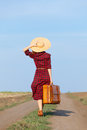 Girl with bag beautiful in plaid dress on countryside Royalty Free Stock Photos