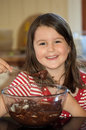 Girl baking chocolate cake Stock Image