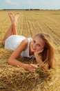 Girl on a bale Royalty Free Stock Photo