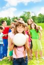 Girl with ball and her team Royalty Free Stock Photo