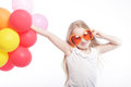 Girl with balloons and orange sunglasses Royalty Free Stock Photo