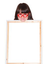 Girl with banner in red glasses holding white frame isolated Stock Photos